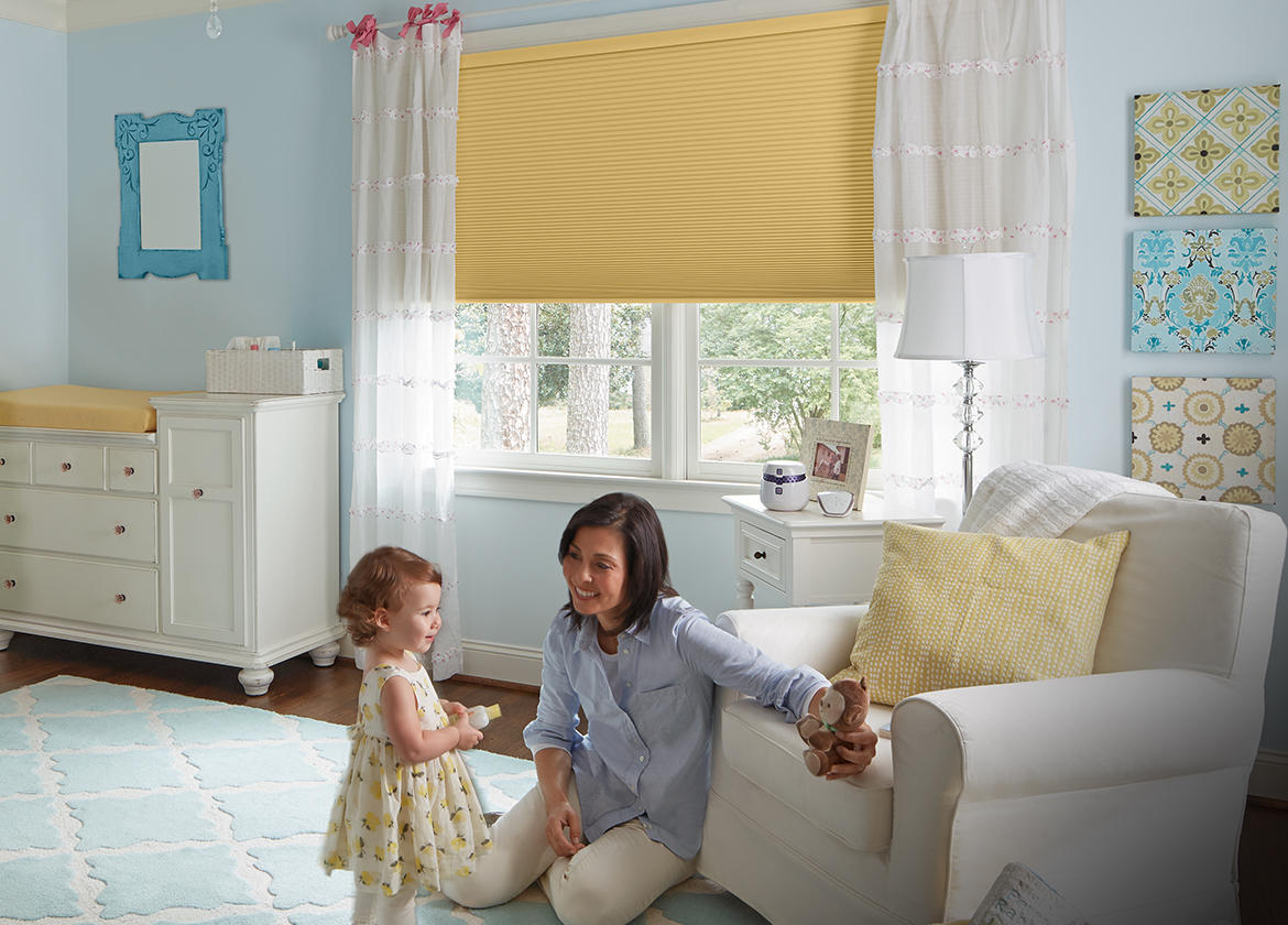Levolor Accordio Cellular Shades in child's nursery. Single-cell, Buttercream color/material style.